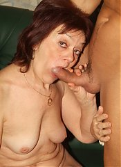 Redhead granny Paula strips on webcam and goes to work riding this younger mans cock live