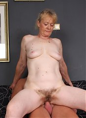 Maria is a beautiful grandma spreading her hairy pussy on the couch during a live sex show